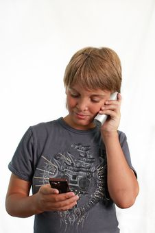 BOY TALKING ON A CELL PHONE . Stock Images