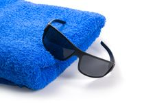 Towel And Sunglasses Royalty Free Stock Images