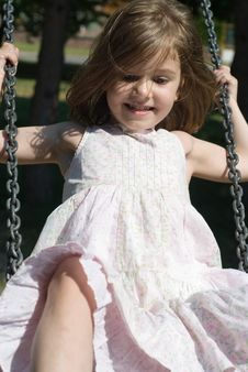 Free Happy Swinging On The Playground Stock Photography - 15365042