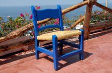 Free Teak Patio Chair Stock Image - 15365181