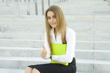 Businesswoman With A Folder Stock Photos