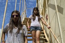 Free Serious Teens On Stairs Royalty Free Stock Images - 15366939