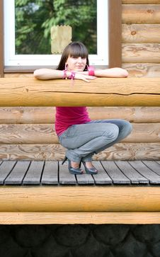 Girl On A Veranda Royalty Free Stock Photography