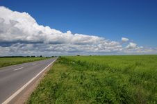 Free Empty Road With Clouds Above Royalty Free Stock Image - 15369196
