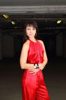 Girl In Red In The Dark Stock Image