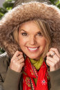 Free Woman Wearing Parka Coat And Scarf In Studio Stock Image - 15375151