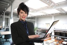 Free Young Businesswoman With Laptop Stock Photo - 15371020