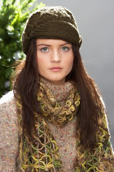 Free Fashionable Teenage Girl Wearing Cap And Knitwear Royalty Free Stock Photo - 15371265