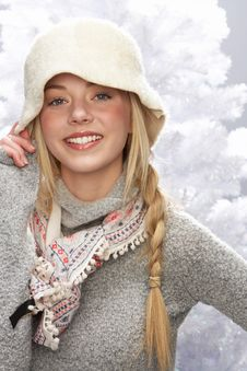 Free Teenage Girl Wearing Cap And Knitwear In Studio Stock Photos - 15372623