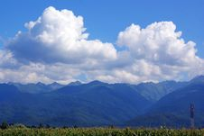 Free Fluffy Clouds Over Far Mountains Royalty Free Stock Image - 15373916