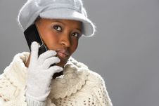Free Woman Wearing Knitwear In Studio Using Mobile Royalty Free Stock Photography - 15375537