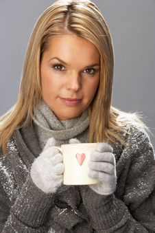 Young Woman Drinking Hot Drink Wearing Knitwear Stock Photos