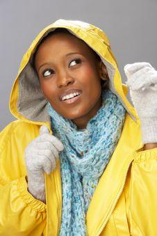 Free Young Woman Wearing Yellow Raincoat In Studio Royalty Free Stock Photo - 15375875