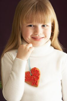 Free Young Holding Heart Shaped Cookie In Studio Stock Photography - 15378522
