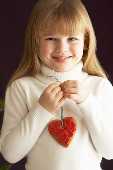 Free Young Girl Holding Heart Shaped Cookie In Studio Stock Photo - 15378560