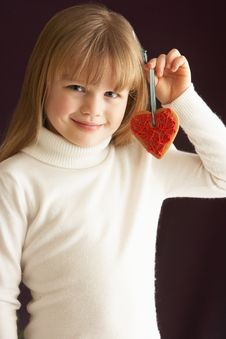 Free Young Girl Holding Heart Shaped Cookie In Studio Royalty Free Stock Photo - 15378575