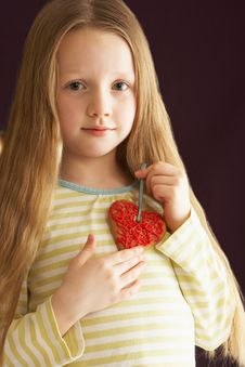 Free Young Girl Holding Heart Shaped Cookie In Studio Royalty Free Stock Photo - 15378625