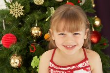 Free Young Girl Decorating Christmas Tree Royalty Free Stock Photos - 15378938