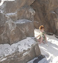 Free Little Boy On Beach Near Rocks Alone Stock Photos - 15384393