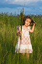 Free Girl Holding Reeds Stock Images - 15388604