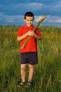 Free Boy Holding Reeds Royalty Free Stock Photos - 15388608