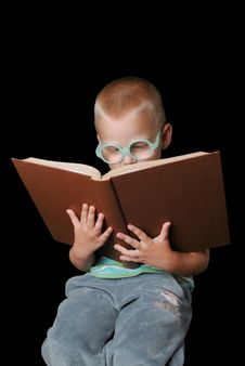 Free Smart Boy With Glasses Reading Book Stock Photography - 15382502