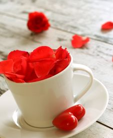 Cup Of Red Rose Petals And Red Heart On Old Wooden Royalty Free Stock Photo