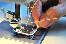 Hand Threading Needle Stock Photo