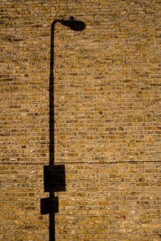 Lamp Post Shadow On Brick Wall Stock Photography