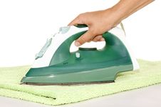 Free Hand With An Iron And Ironing A Towel Royalty Free Stock Photos - 15389808