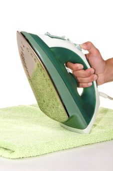 Free Hand With An Iron And Ironing A Towel Stock Photos - 15389853