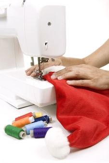 Woman Sewing A Hat For Santa Claus Royalty Free Stock Image