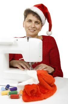 Woman Sewing A Fur Coat For Santa Claus Stock Images