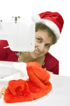Free Woman Sewing A Fur Coat For Santa Claus Royalty Free Stock Images - 15390369
