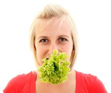 Young Girl With Lettuce Stock Image
