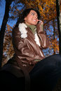 Free Autumn Scene Fall Woman With Cell Phone Stock Photos - 1543793