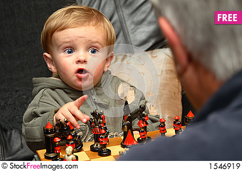 Young boy playing chess Stock Photo
