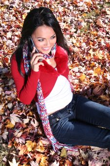 Free Autumn Scene Fall Woman With Cell Phone Stock Photos - 1543423