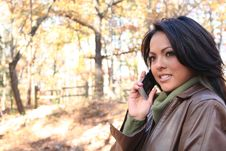 Free Autumn Scene Fall Woman With Cell Phone Stock Images - 1543554