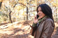 Free Autumn Scene Fall Woman With Cell Phone Royalty Free Stock Photos - 1543558