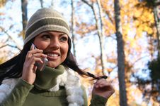 Free Autumn Scene Fall Woman With Cell Phone Royalty Free Stock Photography - 1543717