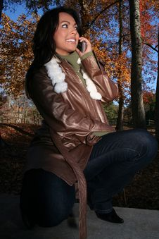 Free Autumn Scene Fall Woman With Cell Phone Royalty Free Stock Photo - 1543785
