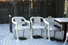 Free Summer Chairs In Winter With Snow Stock Photos - 1544013