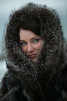 Beautiful Girl In A Fur Coat Stock Photos