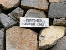 Free A Weathered Customer Parking Only Sign Royalty Free Stock Image - 1545846