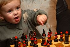 Free Young Boy Playing Chess Stock Photography - 1546992