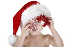 Santa Child With Christmas Bows Stock Photo