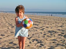 Free Girl Playing At The Beach Royalty Free Stock Photos - 1549548