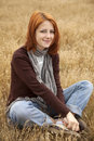 Free Beautiful Red-haired Girl At Yellow Autumn Grass. Royalty Free Stock Photos - 15402698