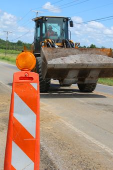Free Tractor In Road Work Zones Stock Photos - 15400223